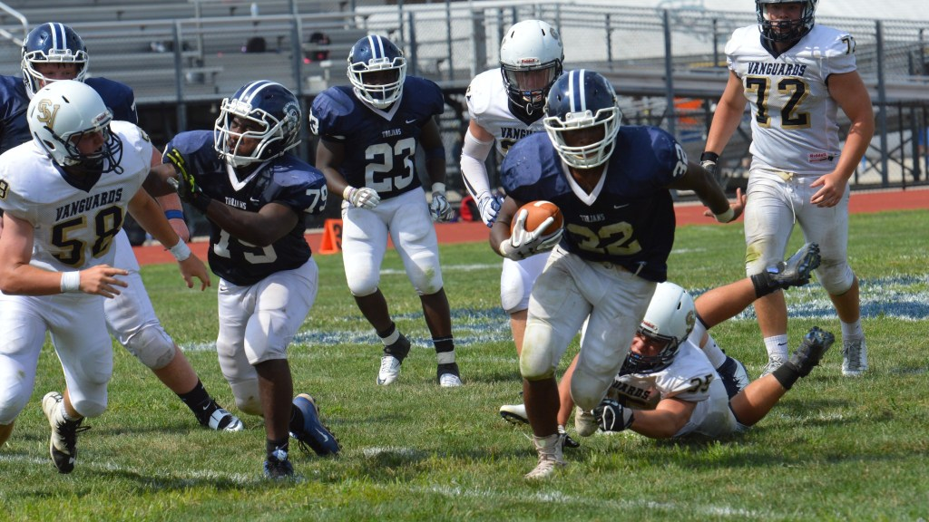 Pottstown's Isaiah Mayes breaks through for a big gain during the second half. (Sam Stewart - Digital First Media)