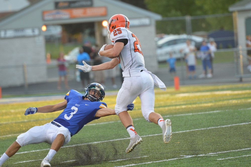 Perkiomen Valley's Justin Jaworski jukes Downingtown West's Cole Zapf on a 53-yard reception Saturday. (Sam Stewart - Digital First Media)