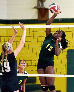 Bob Raines--Digital First Media Lansdale Catholic's Ego Onu spikes the ball past Central Bucks South's Sydney Hauser Sept. 8, 2016.