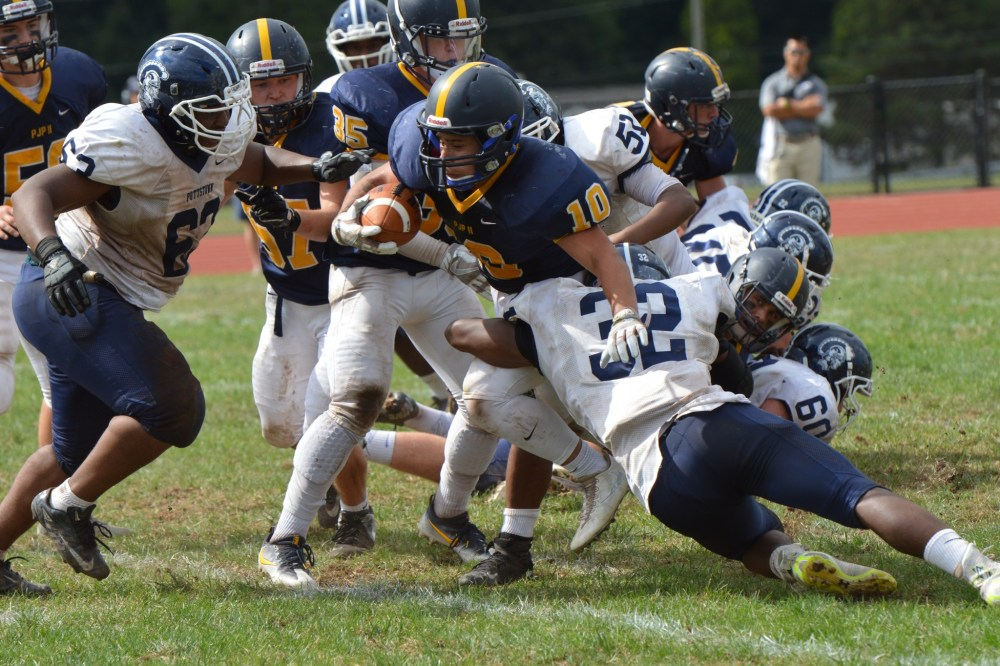 Pope John Paul II's Brandon Knox runs through the hole during the third quarter. (Sam Stewart - Digital First Media)