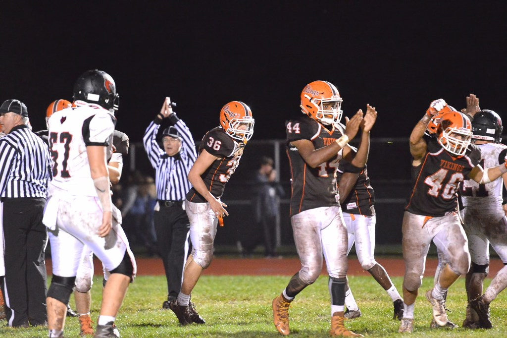 Perkiomen Valley's Joe Zeminski (36), Kevin DelaCruz (44) and Mario Scotese (46) celebrate after the defense recorded a safety in the third quarter. (Sam Stewart - Digital First Media)