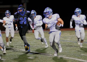 The Patriots Mark DeRobertis cuts the corner asKennett's JuJuan Ramirez prsues.  DeRobertis finished with 121 yards on 9 carries, and a TD