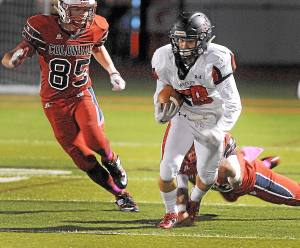 Gene Walsh — Digital First Media Hatboro Horsham's Anthony Kwaitanowski rains for yardage during game against Plymouth Whitemarsh October 14, 2016.