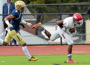 Bob Raines--Digital First Media St.Joe's Prep's fights to keep his balance long enough to score as he is pursued by LaSalle's Tre McNeill Oct. 22, 2016.