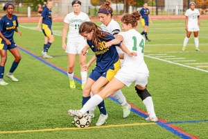 Dani Meenan for Pennridge is defending the ball from Carly Amato during their game against Wissahickon Monday.