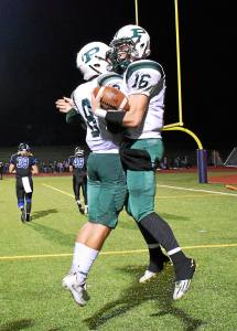 The Rams' Ryan Cuthbert celebrates with Jagger Hartshorn after he scored their second touchdown of Friday night's game against CB South.