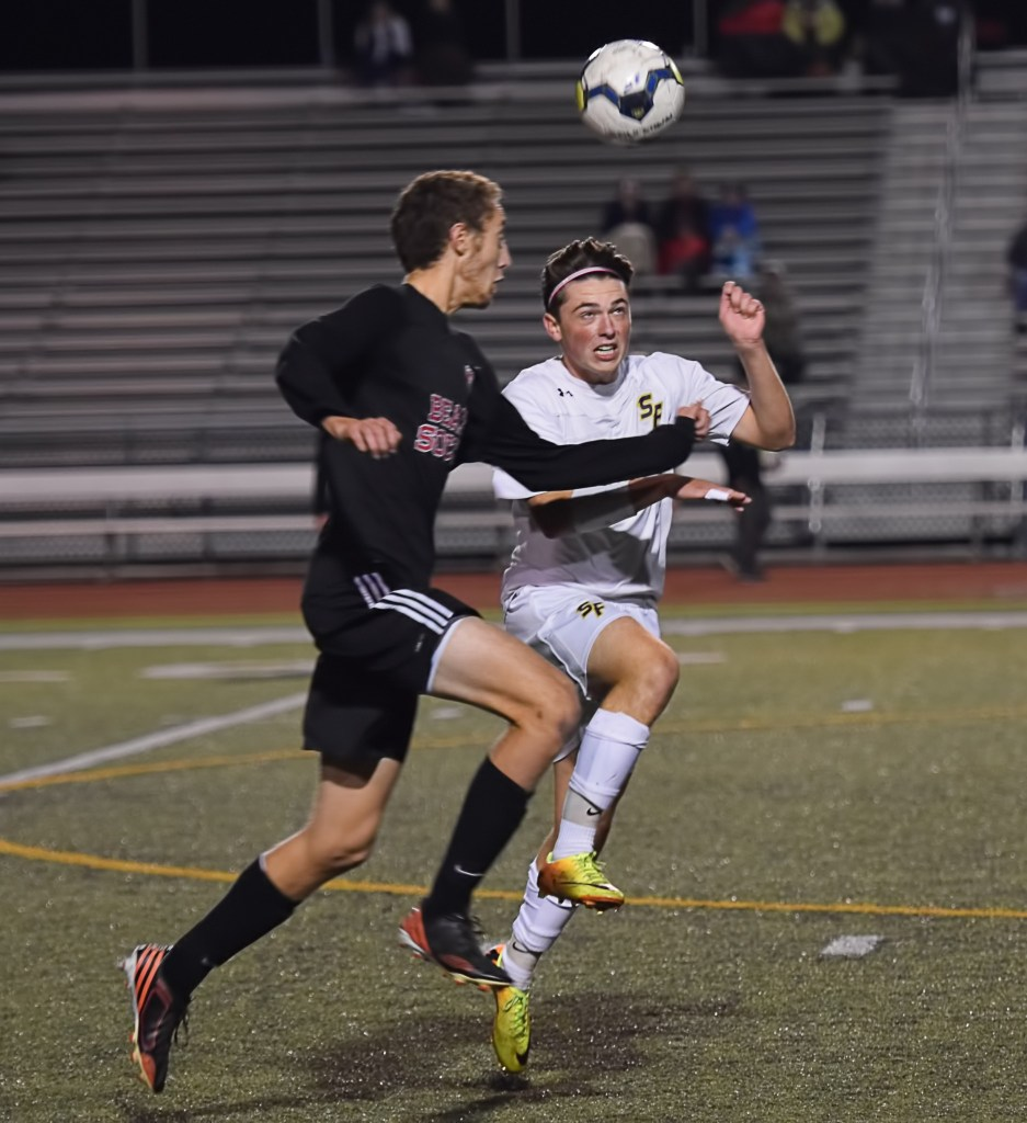 Boyertown's Ben Wise and Spring-Ford's Ronnie Minges vie for a header Tuesday. (Austin Hertzog - DFM)