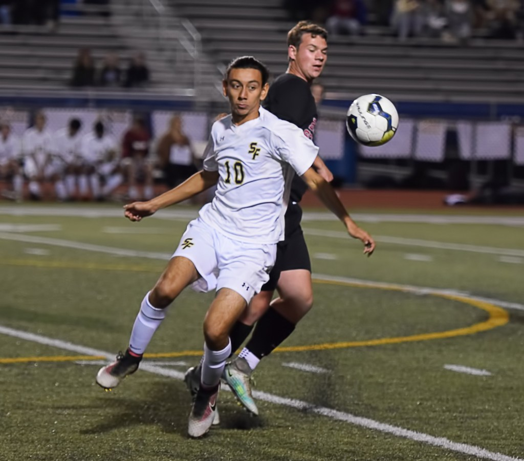 Spring-Ford's Erick Rodriguez looks to control the ball in front of Boyertown's Will Schul. (Austin Hertzog - DFM)