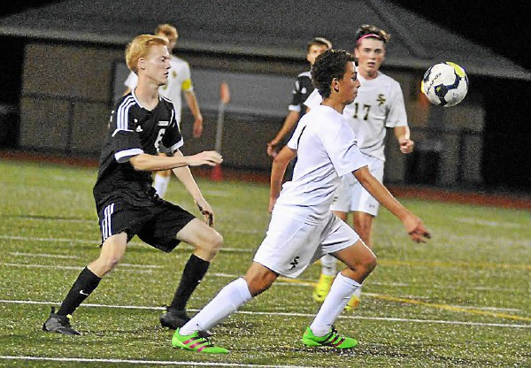 Spring-Ford's Johnny Guimaraes controls the ball as Boyertown's Garrett Halterman defends. (Barry Taglieber - For DFM)