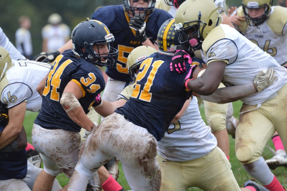 Upper Merion's Charles Sanders muscles his way for extra yards during the Vikings' 24-21 victory. (Sam Stewart - Digital First Media)