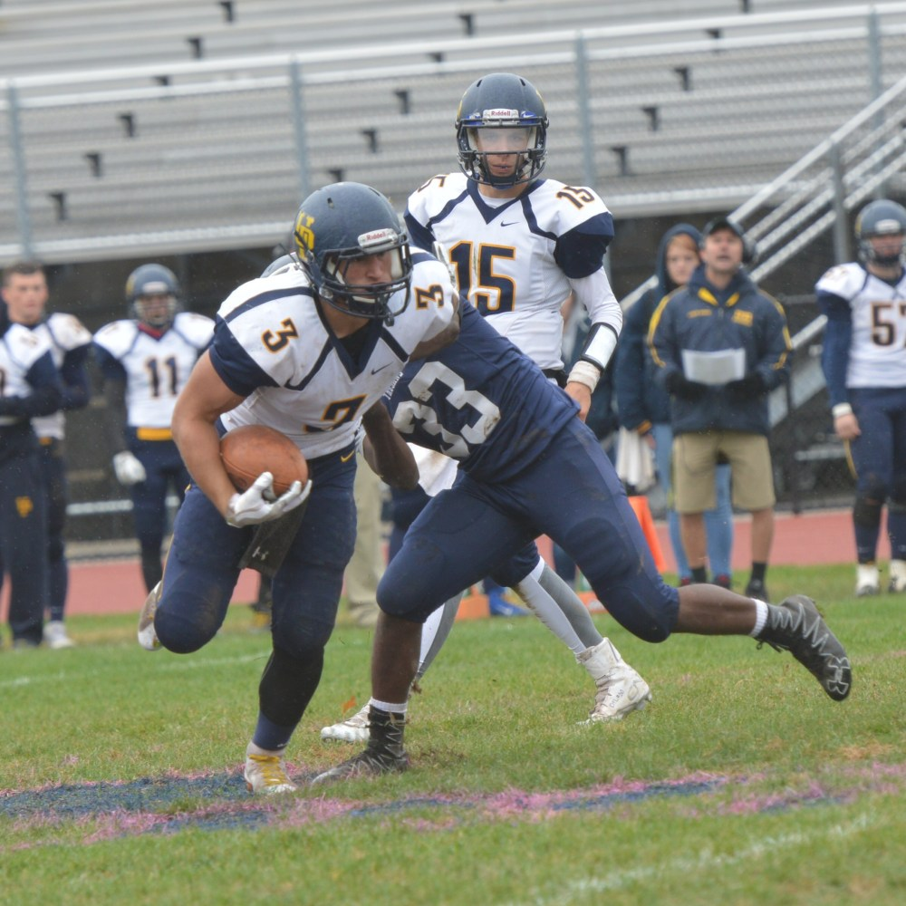Upper Perkiomen's Austin Tutolo breaks a tackle during the first half. (Sam Stewart - Digital First Media)