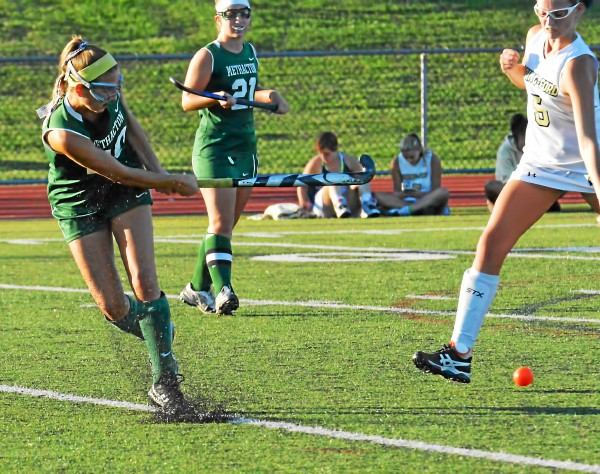 Methacton's Liz Chipman sends one toward goal while Spring-Ford's Clare Kennedy defends. (Sam Stewart - Digital First Media)