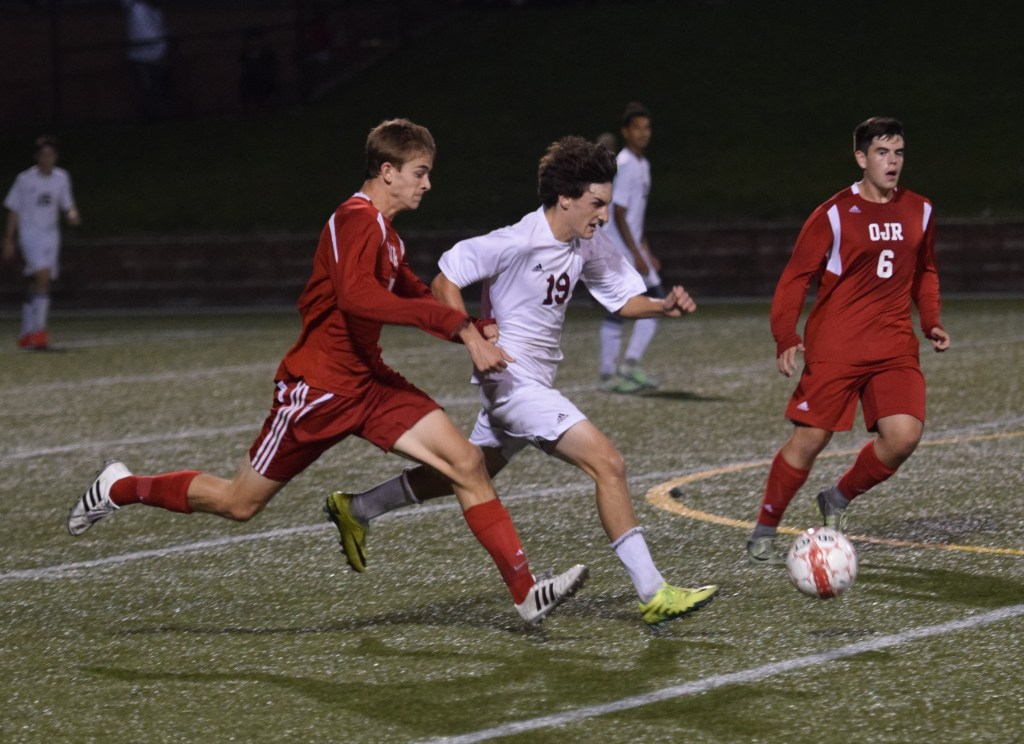 Pottsgrove's Nick Makoid carries the ball out of the back as OJR's Nolan Smith pressures Tuesday. (Austin Hertzog - DFM)