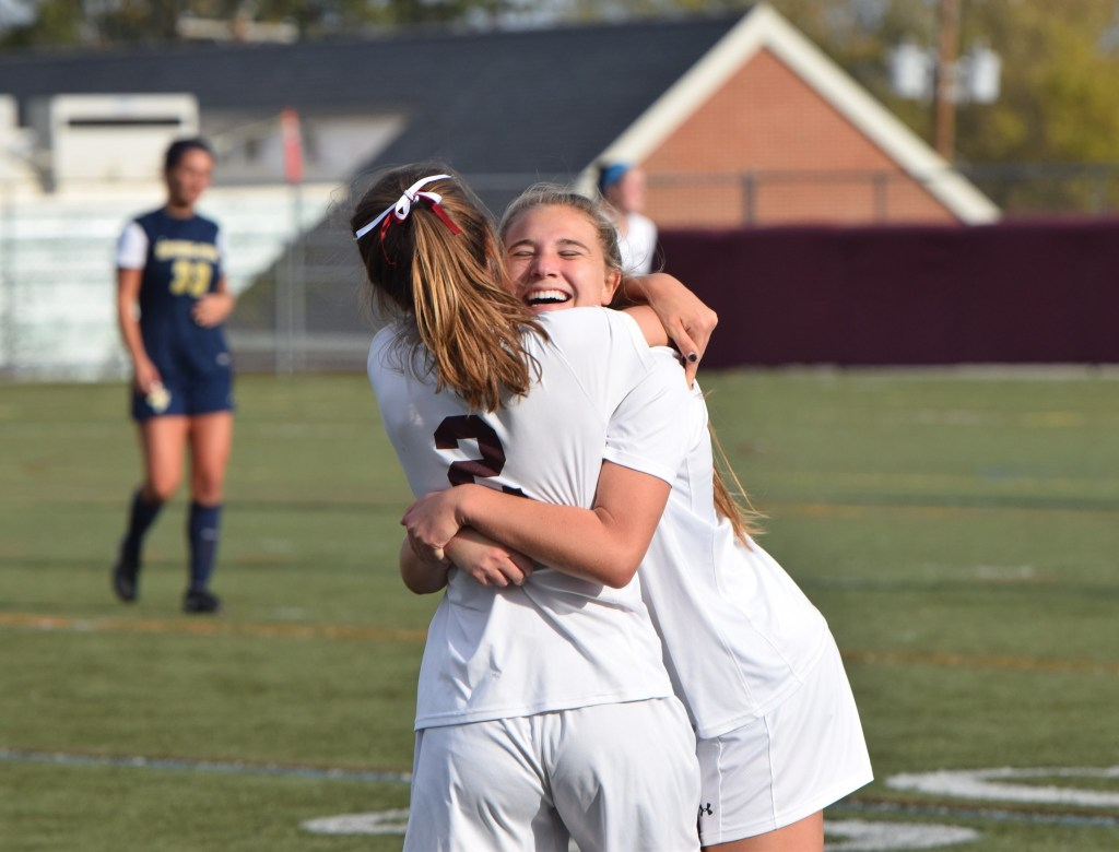 Conestoga's Madie French, facing, hugs Rachel DiRico at the final whistle after the Pioneers defeated Spring-Ford 2-0 during a District 1-AAAA girls soccer quarterfinal on Saturday, Oct. 29. (Austin Hertzog - Digital First Media)