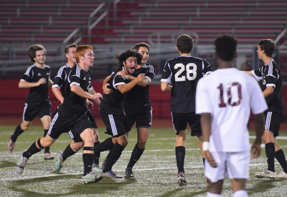 Boyertown's Nik Verma celebrates with teammates after scoring his second goal in the first half Thursday against Pottsgrove. (Austin Hertzog - Digital FIrst Media)
