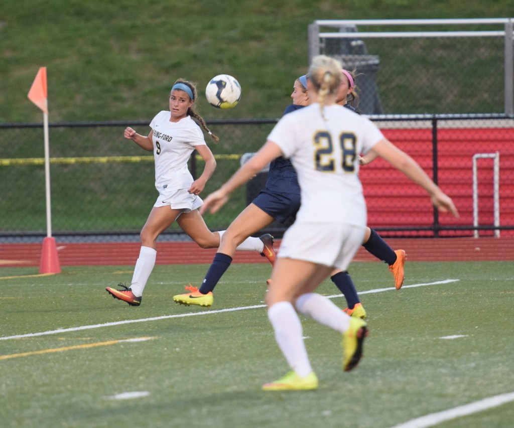 Spring-Ford's Jules Alessandroni watches her cross to Kelly Franz (28) that Franz scored in the second half Tuesday against Pope John Paul II. (Austin Hertzog - DFM)