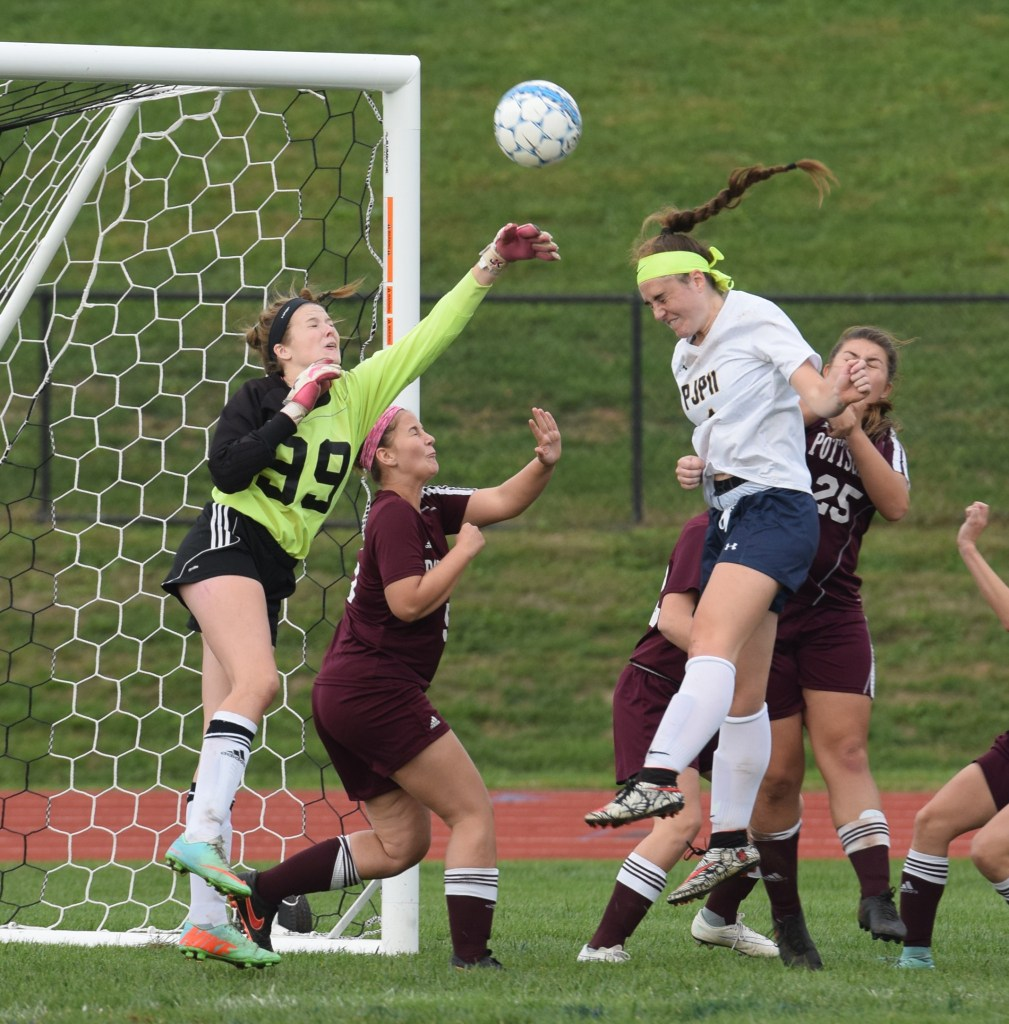 Pope John Paul II's Elizabeth Kropp attempts a header on a corner kick as Pottsgrove goalkeeper Erin Carroll tries to punch the ball away during Thursday's game. (Austin Hertzog - Digital First Media)