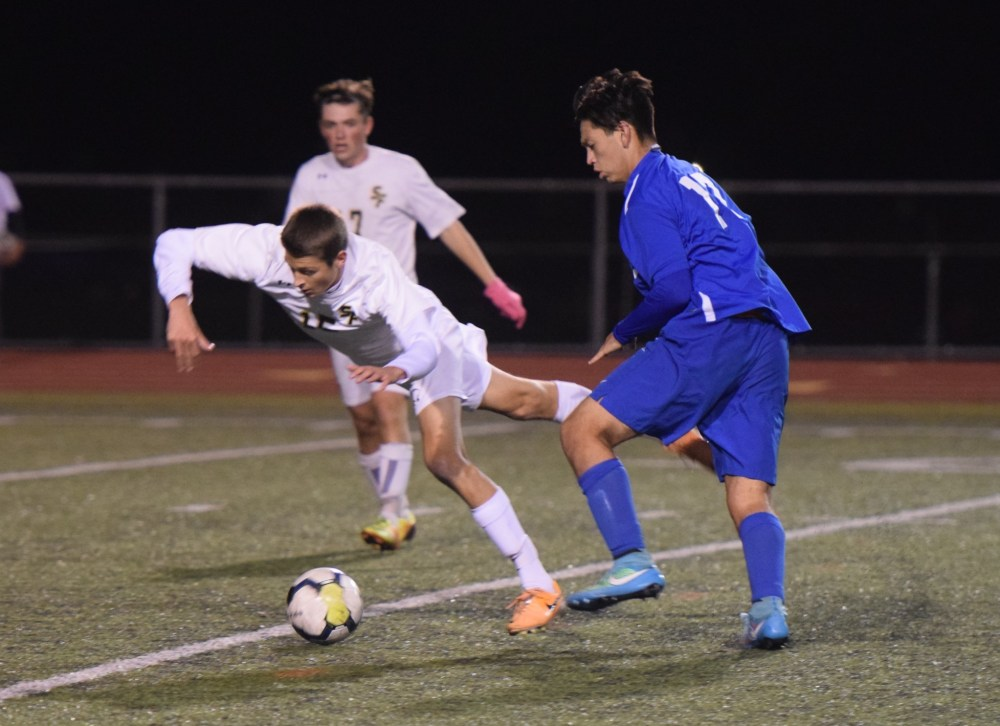 Spring-Ford's Chase Parr is fouled by Kennett's Fernando Esparza-Rodriguez. (Austin Hertzog - Digital First Media)