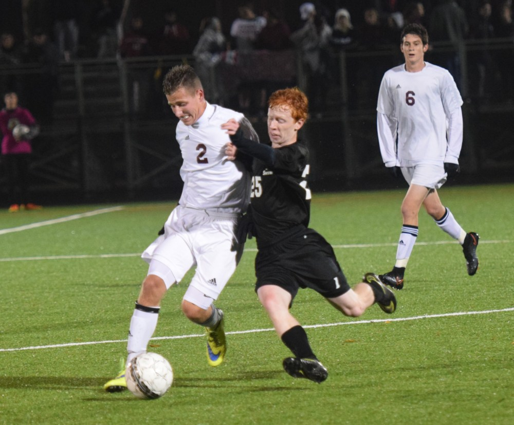 Pottsgrove's Mike Sereny (2) and Interboro's Brian Barker battle for the ball in the midfield Thursday. (Austin Hertzog - Digital First Media)