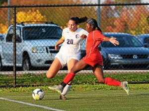 Phoenixville's Sophia Kopko clears the ball from Owen J. Roberts' Mahogany Willis. (Austin Hertzog - Digital First Media)