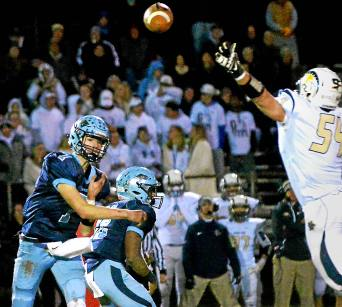 Bob Raines--Digital First Media North Penn quarterback Reece Udinski passes over Spring-Ford's Tanner Romano Nov. 11, 2016.