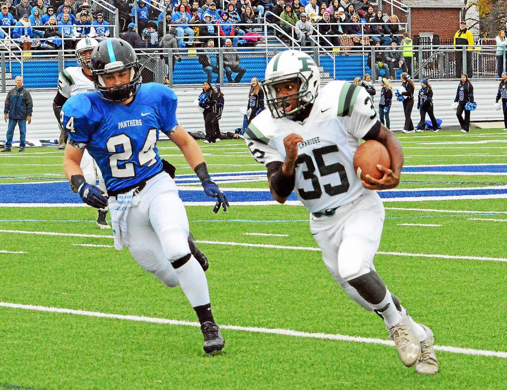 Pennridge's Josh Pinkney races past a Quakertown defender en route to a first-quarter touchdown during their game on Thursday, Nov. 24, 2016. (Debby High/For Digital First Media)