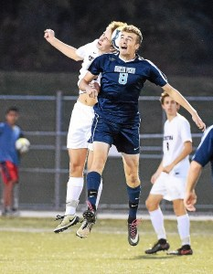 PETE BANNAN-DIGITAL FIRST MEDIA Conestoga #13 Blaise Milanek and North Penn #8 Mike Kohler collide on a header in the first half of their DIstrict 1 PIAA semi-final at Teamer Field Conestoga High School Wednesday evening.