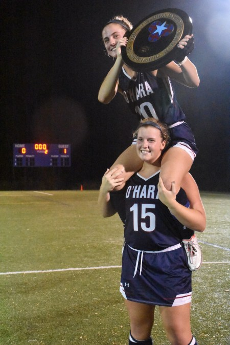 Cardinal O'Hara's Emily Quintus, 15, hoists Makayla Gallen on her shoulders to celebrate the Lions' Catholic League title, won 1-0 over Archbishop Carroll Wednesday. (Digital First Media/Anne Neborak)