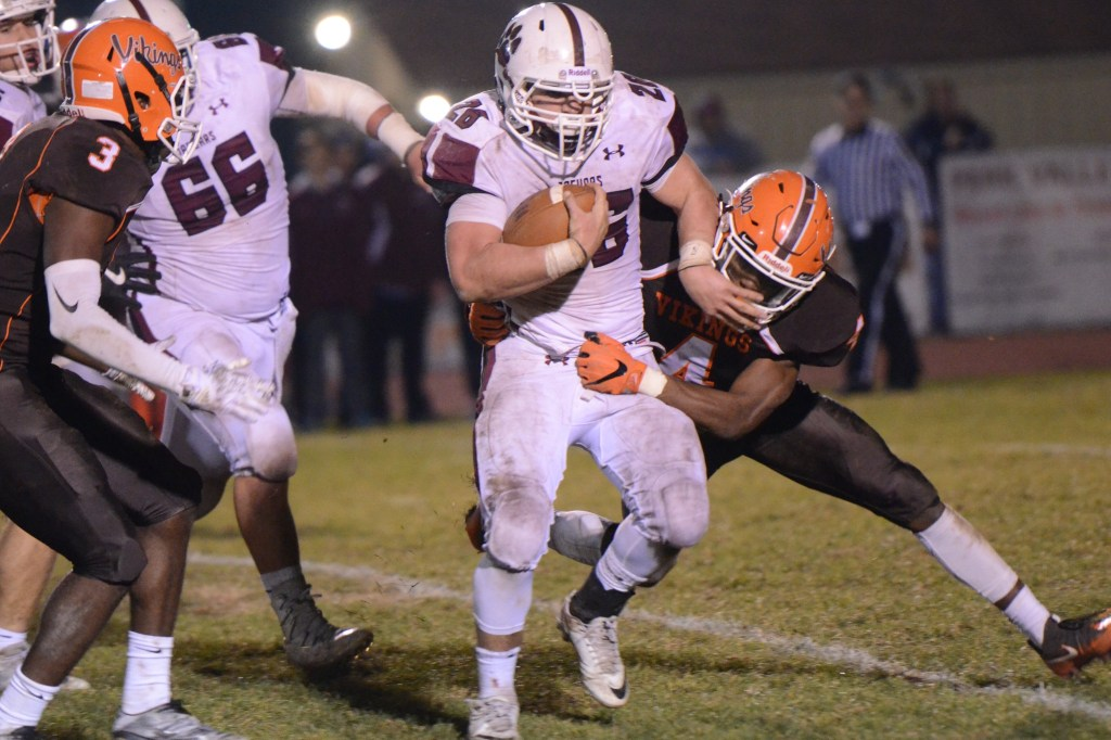 Garnet Valley's Matt Lassik runs through a tackler during the second half. (Sam Stewart - Digital First Media)