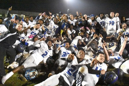 The Academy Park football team poses with its District 1 championship trophy, its third in four years, with a 24-18 win over Springfield in the Class 5A final. (Digital First Media/Anne Neborak)