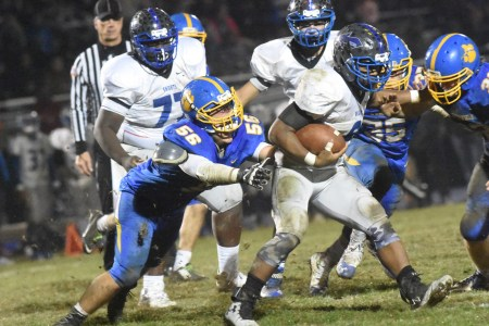 Dazhon Miller, who had a 62-yard scoring run for Academy Park, works the ball through a gauntlet of Springfield defenders, including Dan Gluck and Dwayne Snipes. (Digital First Media/Anne Neborak)
