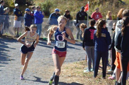 Cardinal O'Hara's Olivia Arizin, fighting off a sinus infection, rolls for the finish line Saturday where she would earn her third straight state medal at the PIAA cross country championships. (Submitted photo)