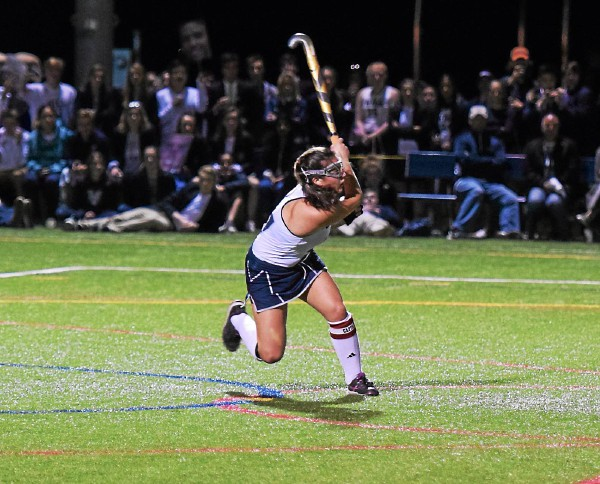 The Hill School's Alexis Grippo follows through on her game-tying penalty stroke against Lawrenceville. (Austin Hertzog - Digital First Media)
