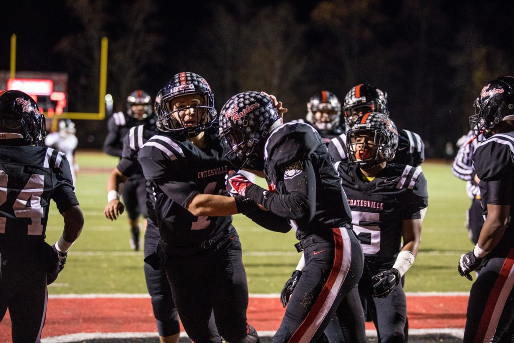 Coatesville's Ricky Ortega and Avery Young celebrate after a first-quarter touchdown (Nate Heckenberger - For Digital First Media).