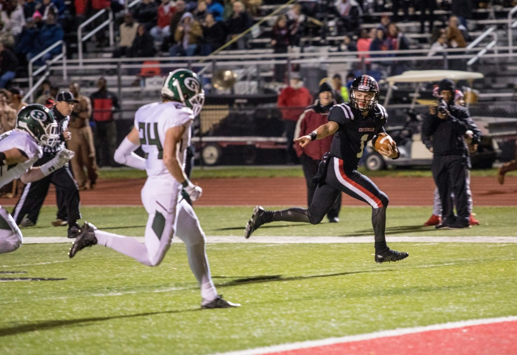 Coatesville's Ricky Ortega runs in a 24-yard touchdown in the first quarter to give the Red Raiders a 21-0 lead against Ridley. (NATE HECKENBERGER)