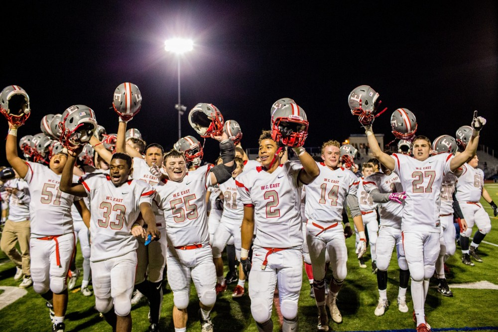 West Chester East players celebrates moments after defeating Unionville, 10-7, in the final seconds. (NATE HECKENBERGER)