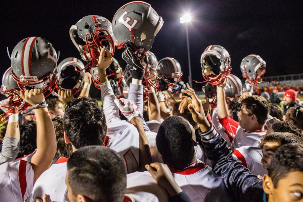 West Chester East players celebrate Friday's win over Unionville. (NATE HECKENBERGER)