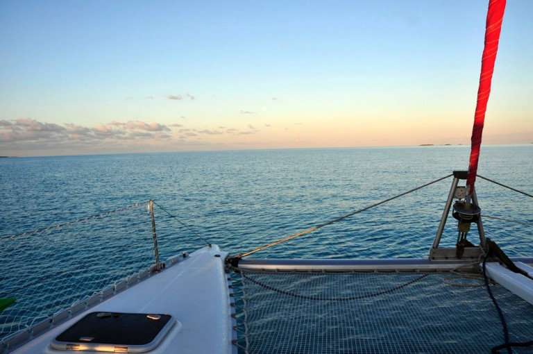 sunset on a catamaran with paradise bay