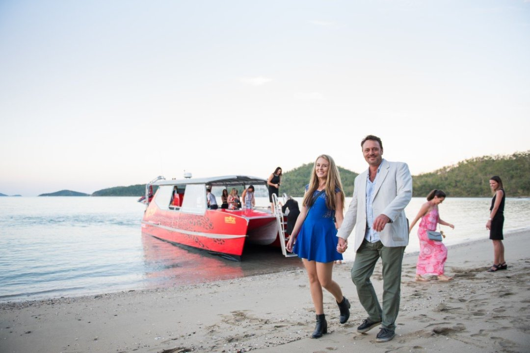 arriving to the wedding by boat , true whitsundays style