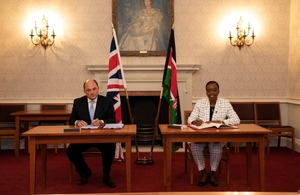 Ben Wallace and Dr Monica Juma sign the agreement in London