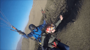 tandem paragliding passenger flying like a bird