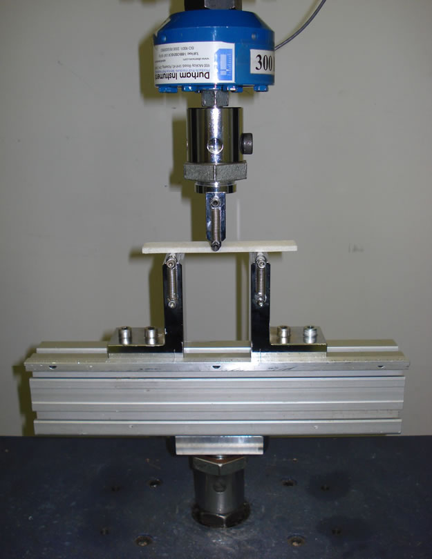ASTM D790 flexural property test fixture setup.
