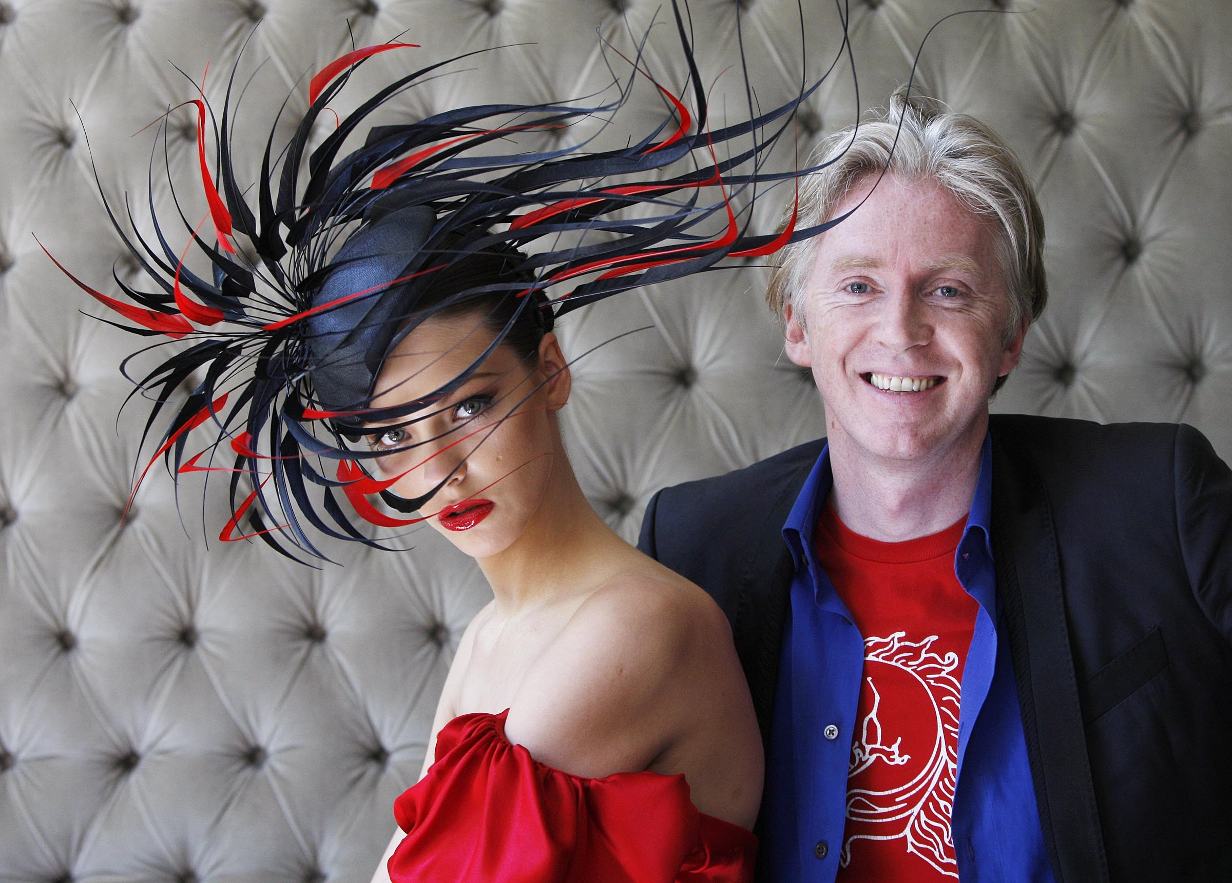 NO REPRO FEE.. Pictured is internationally renowned Irish designer, Philip Treacy with model Klaudia Molenda unveiling his latest creation inspired by Lyons Gold Blend tea on Tuesday 2nd June 2009 in the dylan Hotel, Dublin. The one of a kind hat was specially created to celebrate the rich qualities of Lyons Gold Blend, which new research has revealed as the best tasting gold blend tea, out performing competitors on taste, colour, flavour, appearance and mouth feel in both blind and branded research. The hat will be on display at the Lyons Gold Blend tent at Taste of Dublin 'where great taste meets great style' from 11th June 2009. One lucky person will win the bespoke Philip Treacy creation as Irish people will be able to enter a draw at the Lyons Gold Blend tent and online at www.lyonsgoldblend.ie. Photographer Robbie Reynolds.