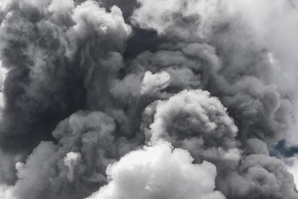 A dense white cloud of fog