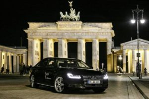Piloted driving Audi A8 L W12 in front of the Brandenburg Gate