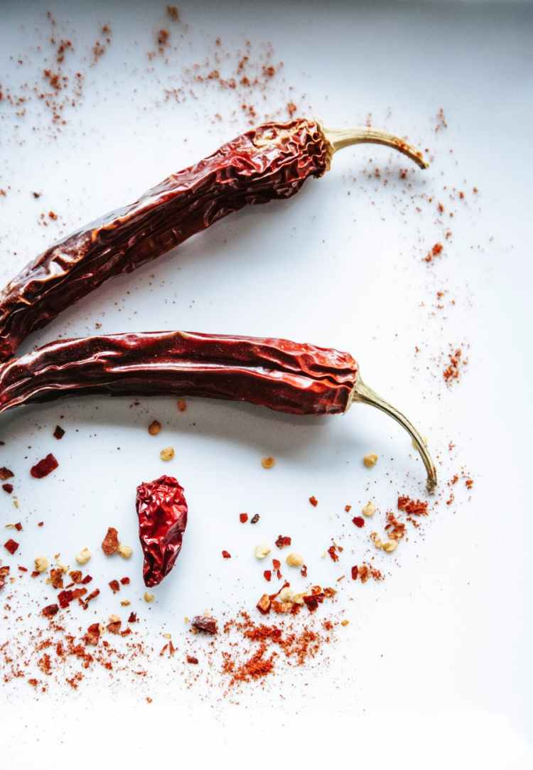 red chili on white surface