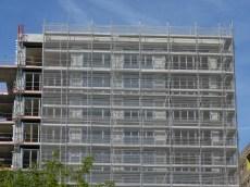 Portes-fenêtres accordéon 6 vantaux du bâtiment A en cours de pose