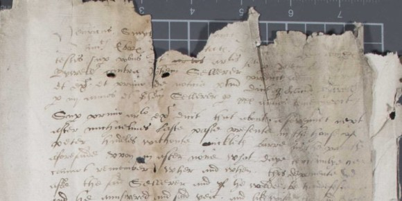 Old document written in secretary hand, with substantial tears at the top edge