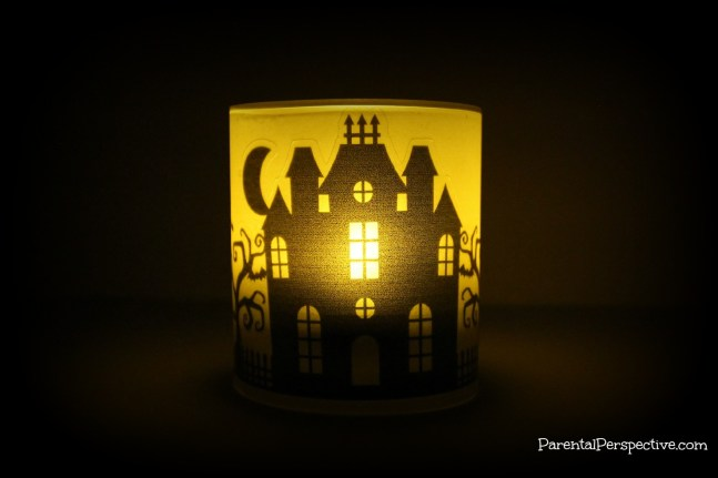 A step by step tutorial for creating a Halloween candle using your Silhouette, vellum, and printable clear sticker paper