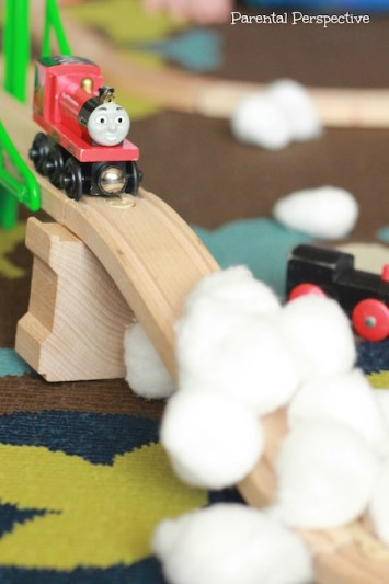 "Use cottonballs as ""snow"" for some fun and creative train play!"